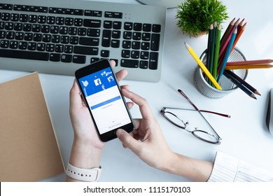 CHIANG MAI, THAILAND - JUN 15, 2018: A woman holds Apple iPhone 6S with facebook application on the screen.facebook is a photo-sharing app for smartphones.