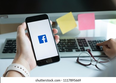 CHIANG MAI, THAILAND - JUN 15, 2018: A woman holds Apple iPhone 6S with facebook application on the screen with facebook icon.facebook is a photo-sharing app for smartphones.