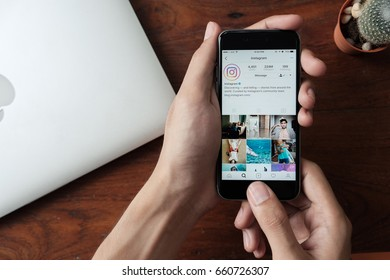 CHIANG MAI, THAILAND - JUN 15,2017: A man holds Apple iPhone with Instagram application on the screen. Instagram is a photo-sharing app for smartphones.