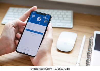 CHIANG MAI  ,THAILAND JUN 22 2018 : Woman holding a iPhone X with social Internet service Facebook on the screen.