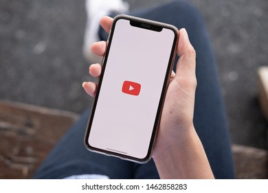 CHIANG MAI ,THAILAND JUN 22 2019 : Woman holding a iPhone Xs or iPhone 10 with social Internet service Youtube on the screen