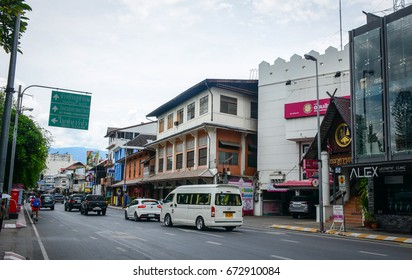 Chiang Mai, Thailand - Jun 22, 2016. Vehicles run on street at downtown in Chiang Mai, Northern Thailand. In 2016, tourist arrivals are expected to grow by approximately 10 percent to 9.1 million.