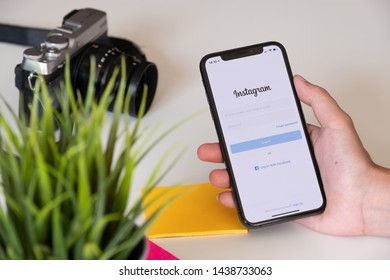 CHIANG MAI, THAILAND - JUN 23, 2019: A woman holds Apple iPhone X with Instagram application on the screen. Instagram is a photo-sharing app for smartphones.