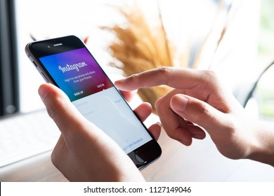 CHIANG MAI, THAILAND - JUN 30, 2018: A woman holds Apple iPhone 6S with Instagram application on the screen. Instagram is a photo-sharing app for smartphones.