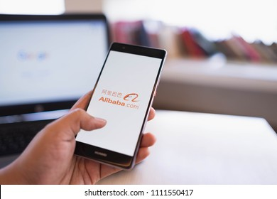 CHIANG MAI, THAILAND - June 03,2018: Man hands holding HUAWEI with alibaba apps on screen. Alibaba's the the world's biggest online commerce company. It's three main sites Taobao,Tmall and Alibaba.