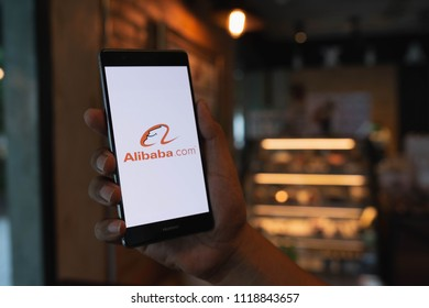CHIANG MAI, THAILAND - June 09,2018: Man hands holding HUAWEI with alibaba apps on screen. Alibaba's the the world's biggest online commerce company. It's three main sites Taobao,Tmall and Alibaba.