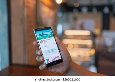 CHIANG MAI, THAILAND - June 09,2018: Man holding HUAWEI with Google Maps on the screen.Google Maps is most popular mapping service for mobile provided by Google.