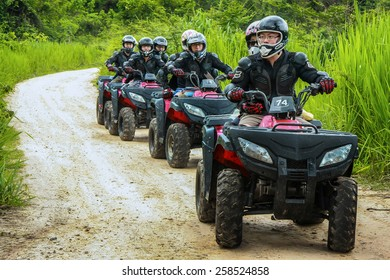 CHIANG MAI, THAILAND - JUNE 10 : Tourists riding ATV to nature adventure on dirt track on JUNE 10, 2014 in Chiang Mai, Thailand.