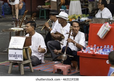 Chiang Mai, Thailand - June 14, 2015: A group of elders show in exchange for donations to the Sunday Walking Street night Market.on June 14 , 2015 in Chiang Mai.