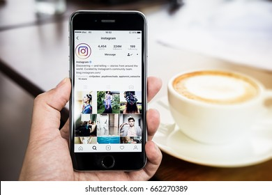 CHIANG MAI, THAILAND - June 16, 2017: A woman holds Apple iPhone 6S with Instagram application on the screen. Instagram is a photo-sharing app for smartphones.