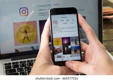CHIANG MAI, THAILAND - JUNE 24, 2017: A man hand holding iphone with new logo of instagram application. Instagram is largest and most popular photograph social networking.
