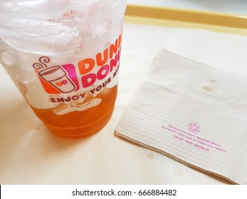 CHIANG MAI, THAILAND - JUNE 24 : glass of iced coffee of Dunkin Donuts shop with recycle paper on the tray on June 24, 2017 in Chiang mai, Thailand.