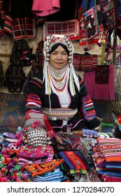 Chiang Mai, Thailand - June 26, 2017: Mature ethnic Akha woman with traditional attire sale the souvenir at the local market in hill tribe minority village at Chiangmai, Thailand.