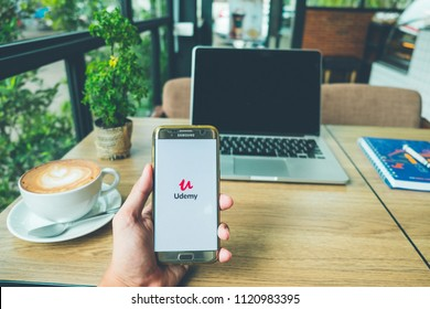 CHIANG MAI, THAILAND - June 26,2018: A Man holds Samsung Galaxy S7 edge Mobile Phone with Udemy application on the screen in coffee shop. Udemy is an online learning platform