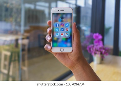 CHIANG MAI, THAILAND - Mar 02,2018: Man holding Apple iPhone 6S Rose Gold with icons of social media on screen. Social media are most popular tool.  Smartphone lifestyle. Starting social media app.