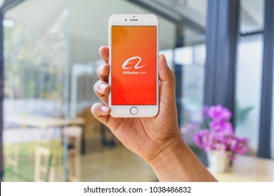 CHIANG MAI, THAILAND - Mar 02,2018: Man holding Apple iPhone 6S Rose Gold with alibaba apps. Alibaba the the world biggest online commerce company. Its three main sites Taobao,Tmall and Alibaba.