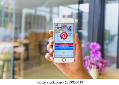 CHIANG MAI, THAILAND - Mar 02,2018: Man holding Apple iPhone 6S Rose Gold with Pinterest apps login on screen. Pinterest is an online pinboard that allows people to pin their interesting things.