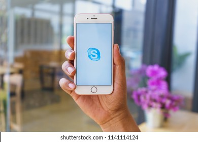 CHIANG MAI, THAILAND - Mar 02,2018: Man holding Apple iPhone 6S Rose Gold with skype apps. Skype is part of Microsoft, can make video, audio calls, chat messages and do much more using Skype.