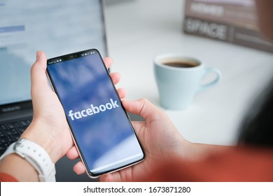 Chiang Mai Thailand. Mar  08, 2020. Woman holds  smart phone with facebook application on the screen. facebook is a photo-sharing app for smartphones