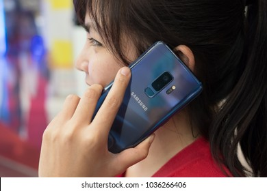 CHIANG MAI , THAILAND - MAR 1, 2018: A Woman Talking with Smartphone Samsung Galaxy S9 Plus with Coral Blue new color.