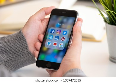 CHIANG MAI, THAILAND - MAR 13 ,2019: Woman holding Apple iPhone 6S with icons of social media on screen. Social media are most popular tool. Smartphone life style. Starting social media app.