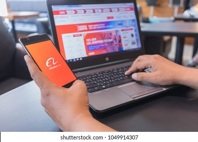 CHIANG MAI, THAILAND - Mar 18,2018: Man hands holding HUAWEI with alibaba apps on screen. Alibaba the the world biggest online commerce company. Its three main sites Taobao,Tmall and Alibaba.