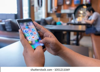 CHIANG MAI, THAILAND - Mar 18,2018: Man holding HUAWEI with icons of social media on screen. Social media are most popular tool.  Smartphone lifestyle. Starting social media app.