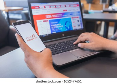 CHIANG MAI, THAILAND - Mar 18,2018: Man hands holding HUAWEI with alibaba apps on the screen. Alibaba's the the world's biggest online commerce company. Its three main sites Taobao,Tmall and Alibaba.