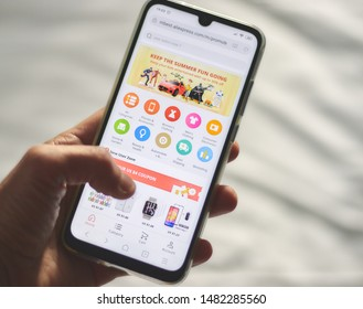 CHIANG MAI, THAILAND - MAR 22,2019: Man hands holding smartphone with aliexpress applications on the screen. aliexpress is the world's largest online trading company. online shopping of goods.