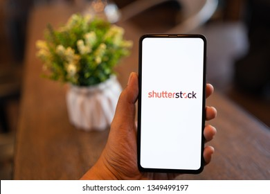 CHIANG MAI, THAILAND - Mar. 24,2019: Man holding Xiaomi Mi Mix 3 with Shutterstock on screen. Shutterstock is a world leader in stock photography, vectors, illustrations, and video.