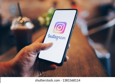 CHIANG MAI, THAILAND - Mar. 24,2019: Man holding Xiaomi Mi Mix 3 with Instagram application on the screen. Instagram is a popular online social networking service.