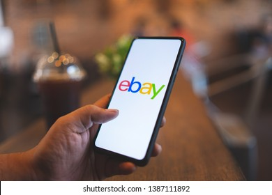 CHIANG MAI, THAILAND - Mar. 24,2019: Man holding Xiaomi Mi Mix 3 with eBay apps on the screen. eBay is one of the most popular ways to buy and sell goods and services on the internet.