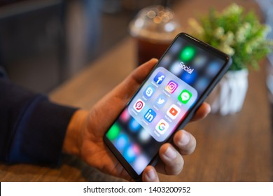 CHIANG MAI, THAILAND - Mar. 24,2019: Man holding Xiaomi Mi Mix 3 with icons of social media on the screen.Social media are most popular tool. Smartphone lifestyle. Starting social media app.