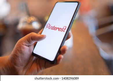 CHIANG MAI, THAILAND - Mar. 24,2019: Man holding Xiaomi Mi Mix 3 mobile phone with Pinterest apps login on screen. Pinterest is an online pinboard that allows people to pin their interesting things.