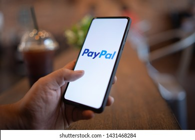 CHIANG MAI, THAILAND - Mar. 24,2019: Man holding Xiaomi Mi Mix 3 with PayPal apps on the screen. PayPal is an online electronic payment system.