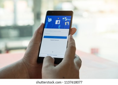 CHIANG MAI. THAILAND. MAR 28, 2018. Person holding a HUAWEI P10 with Facebook application on the screen. Facebook is a social media online service.