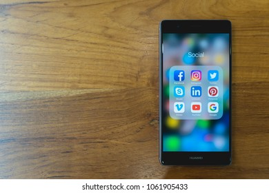 CHIANG MAI, THAILAND - Mar 28,2018:HUAWEI  mobile phone with icons of social media on the screen. Social media are most popular tool. Smartphone lifestyle. Starting social media app.
