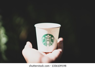 CHIANG MAI, THAILAND - MAR 5, 2019: hand holding starbucks paper cup with dark background, analysts think starbucks might launch cannabis-infused drinks first