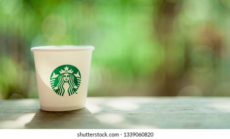 CHIANG MAI, THAILAND - MAR 5, 2019: starbucks paper cup on wooden table, starbucks is well known global coffee company that analysts think might launch cannabis-infused drinks first