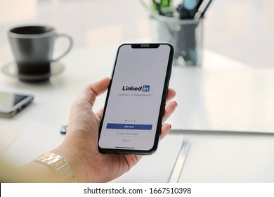 CHIANG MAI, THAILAND, MAR 7, 2020 : A women holds Apple iPhone Xs with LinkedIn application on the screen.LinkedIn is a photo-sharing app for smartphones.