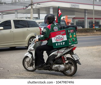 CHIANG MAI, THAILAND -MARCH 1 2018: Delivery service man ride a Motercycle of The Pizza Company. On road no.1001, 8 km from Chiangmai city.