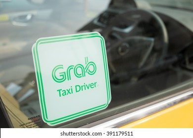 CHIANG MAI, THAILAND -March 14, 2016:Sticker sign of Grab Taxi  on a window car,Grab Taxi is a mobile e-hailing application available in six countries.