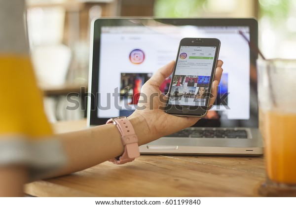 CHIANG MAI, THAILAND - MARCH 15, 2017: Selective focus of women hand holding iphone with new logo of instagram application. Instagram is largest and most popular photograph social networking.