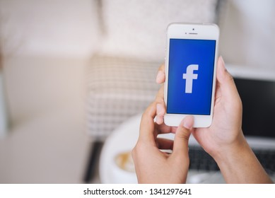 Chiang Mai, Thailand. March 16, 2019. A women holds Apple iPhone with facebook application on the screen.facebook is a photo-sharing app for smartphones.