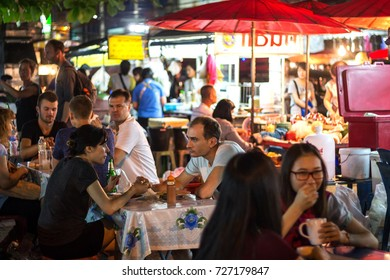 CHIANG MAI, THAILAND - MARCH 16 : Unidentified asian people selling food to tourists from all over the world at street night market in the evening on March 16, 2016 in Chiang Mai, Thailand.