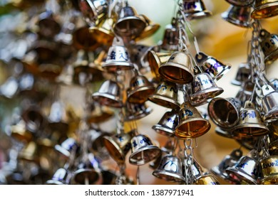 Chiang Mai, Thailand - March 21, 2019: Small golden bells bringing luck and harmony at a temple in Chiang Mai city in Thailand, temple Wat Phra Singh