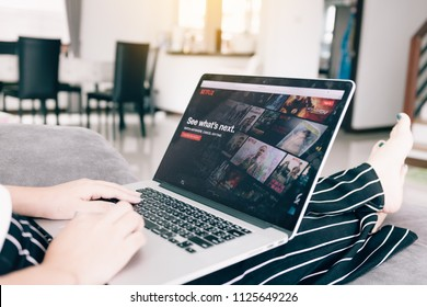 CHIANG MAI ,THAILAND - March 31, 2018 : Woman using computer laptop and watching Netflix website. Netflix being popular internationally.