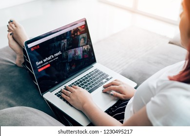 CHIANG MAI ,THAILAND - March 31, 2018 : Woman using computer laptop and watching Netflix website.