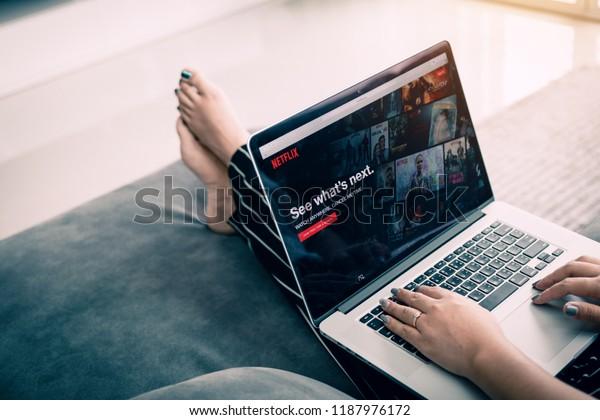 CHIANG MAI ,THAILAND - March 31, 2018 : Woman using computer laptop and watching Netflix website. Netflix being popular internationally.