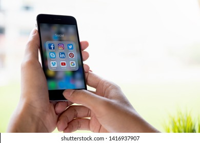 CHIANG MAI, THAILAND - MAY 01,2019: Man holding Apple iPhone 6S with icons of social media on screen. Social media are most popular tool. Smartphone life style. Starting social media app.